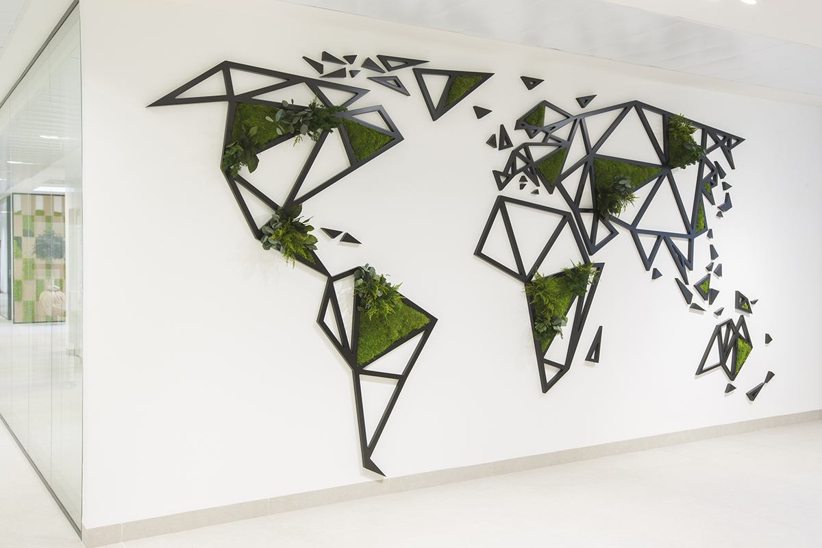 benefits of biophilia in offices with world map of preserved plants